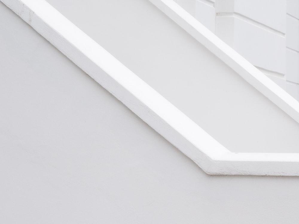 white concrete wall with white window