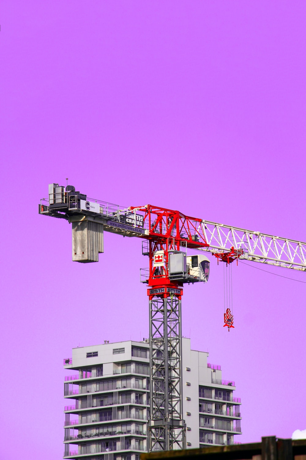 red and gray crane under blue sky during daytime
