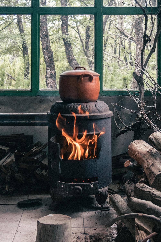 brown clay pot on black wood burner