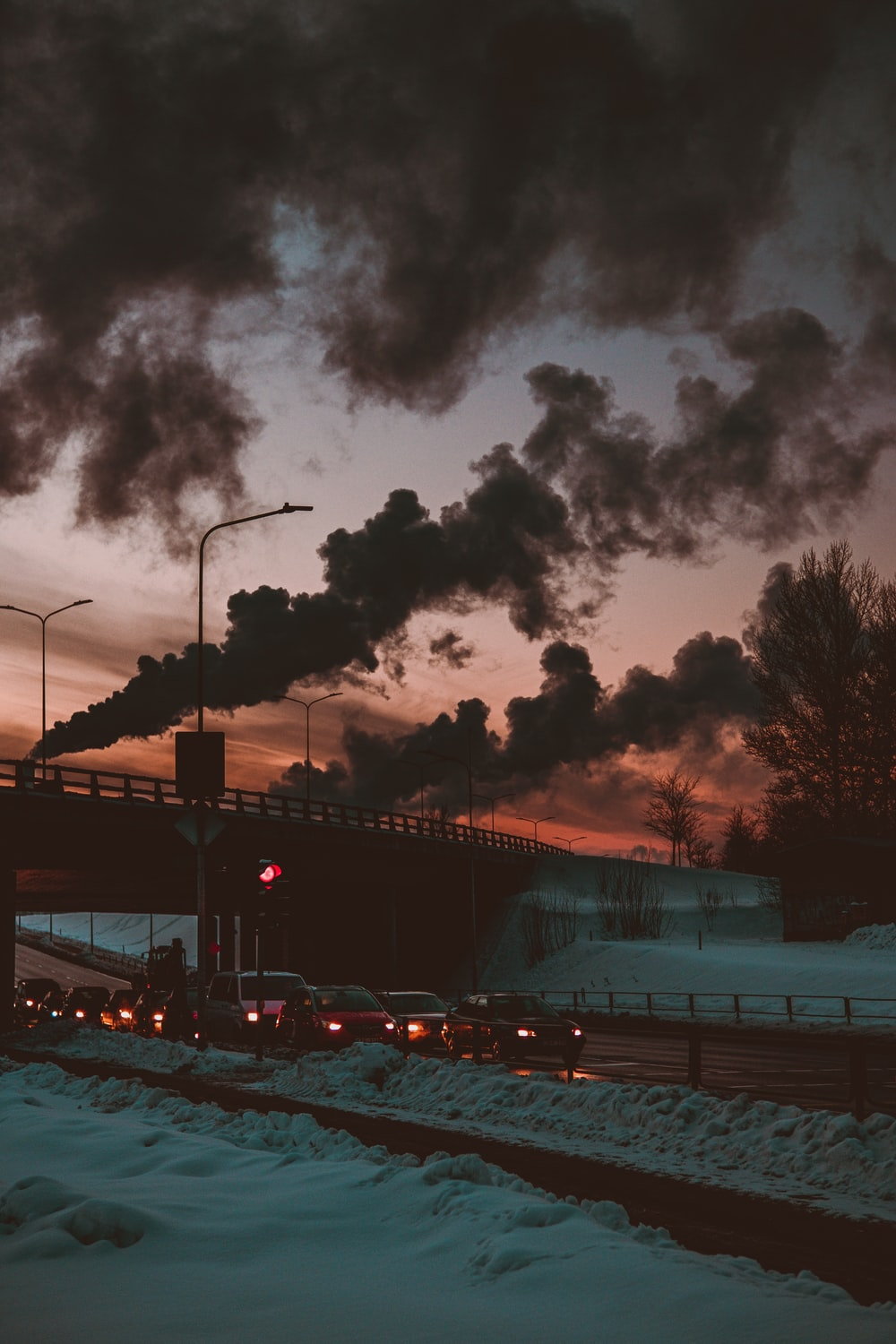 cars on road under cloudy sky during night time