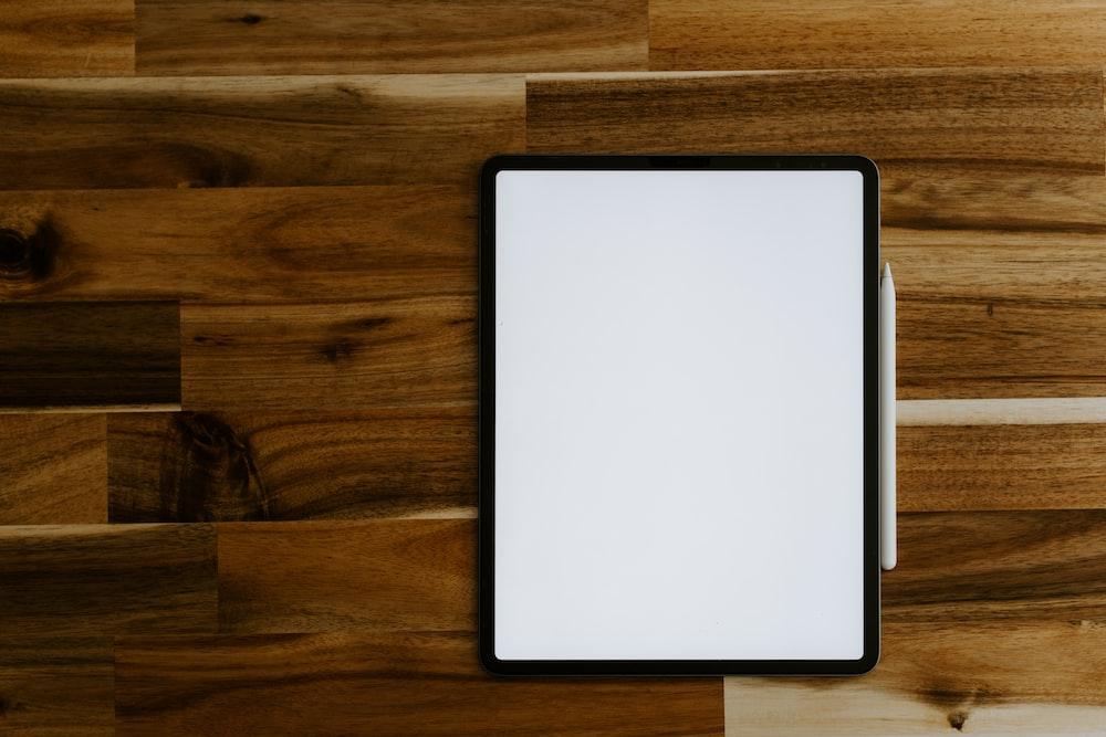 white rectangular frame on brown wooden table