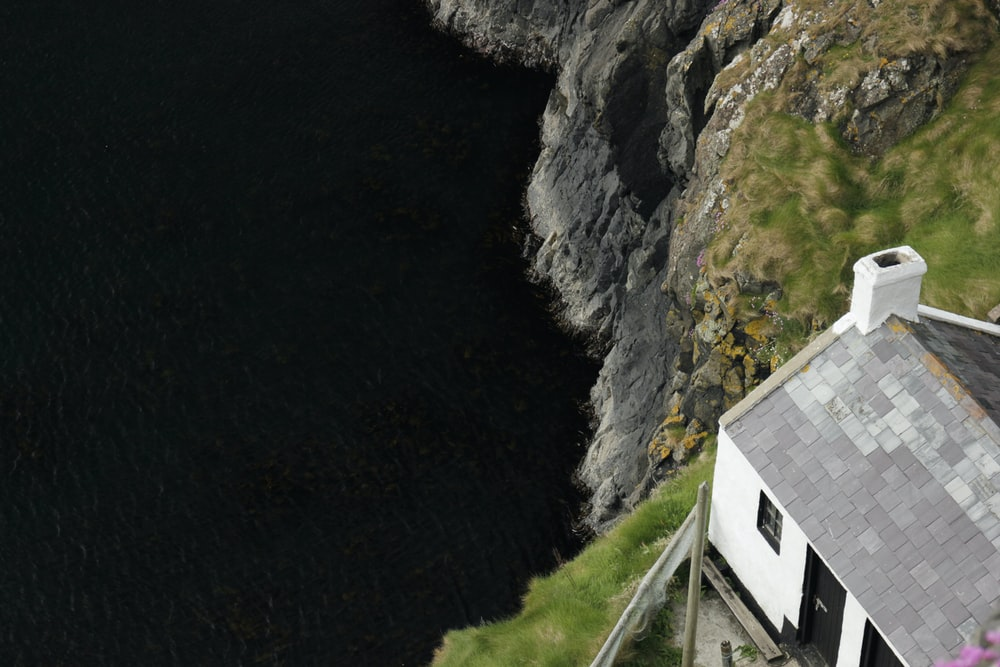 white and black house on cliff