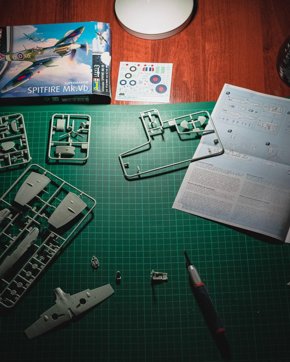 black click pen beside white printer paper on table