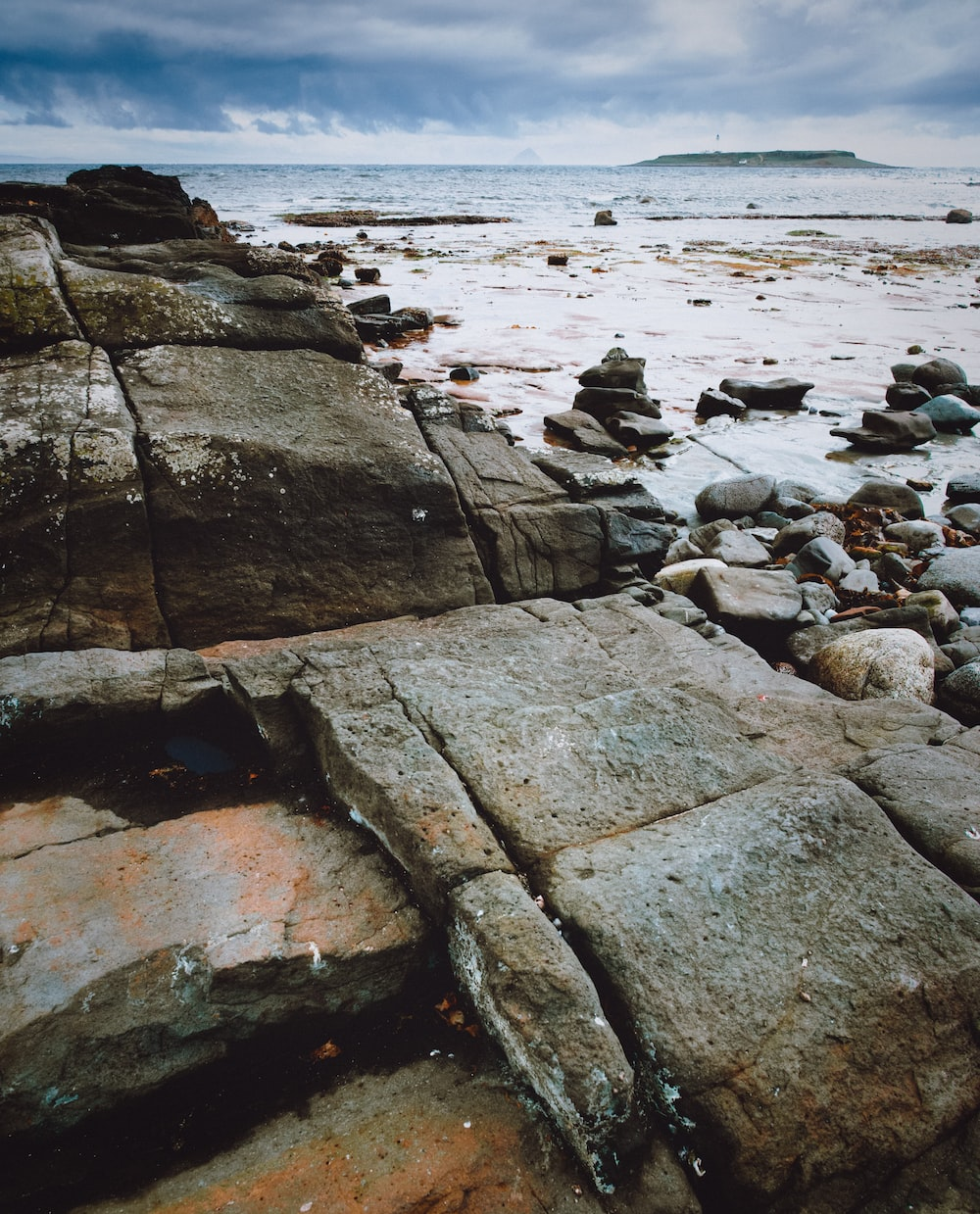 brown rock formation near sea during daytime