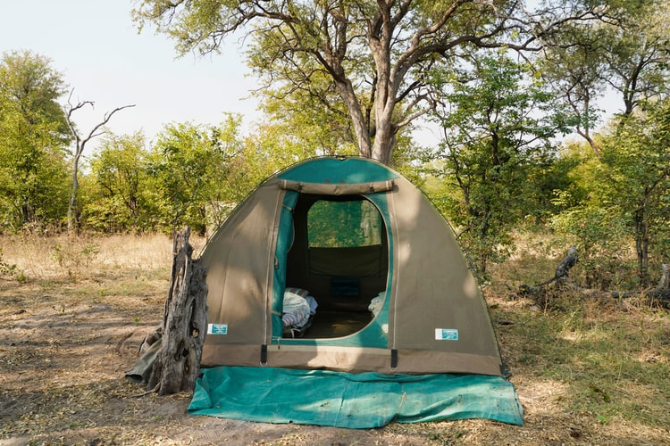 camping tent with blanket in front