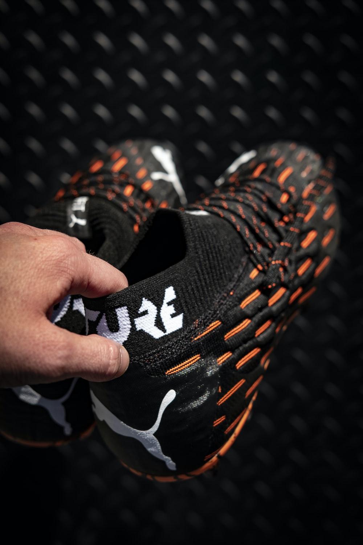 black and orange nike athletic shoes