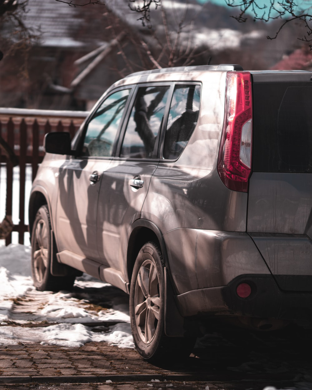 grey suv on snow covered ground during daytime