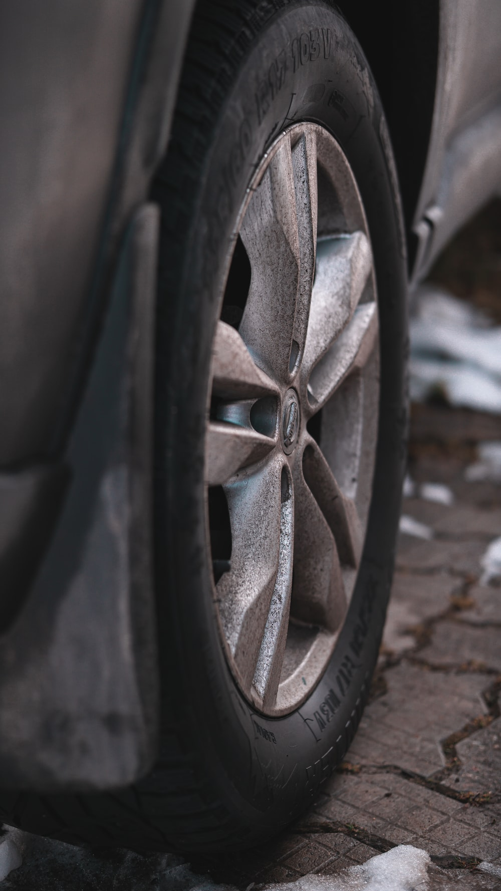 black car wheel on brown concrete floor