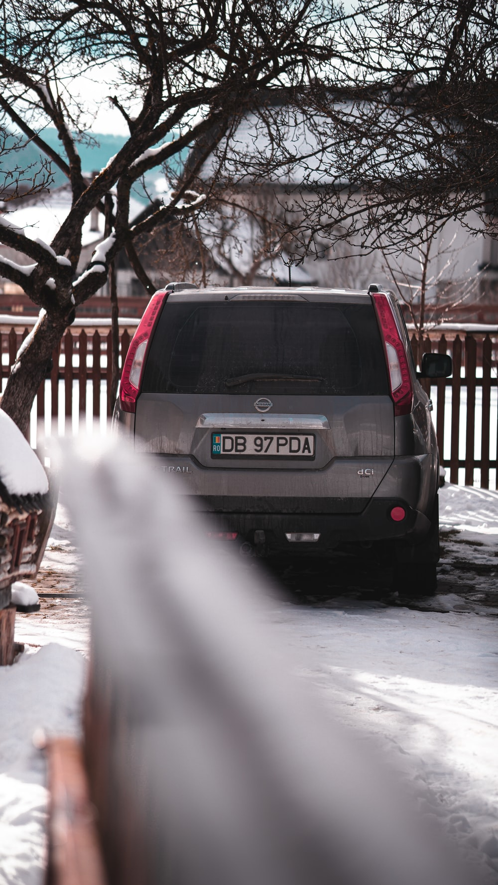 black honda car on snow covered road