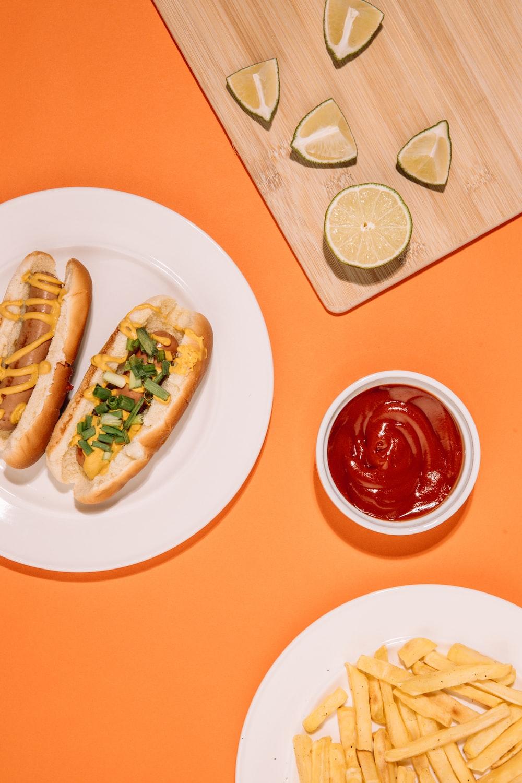 hotdog sandwich on white ceramic plate