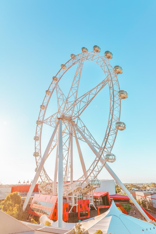 white ferris wheel under blue sky during daytime