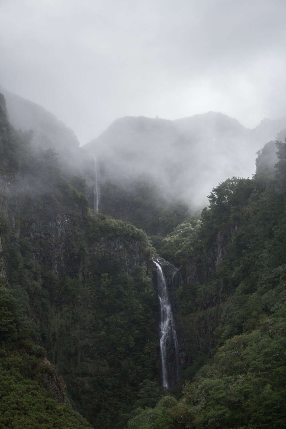 waterfalls in foggy weather during daytime