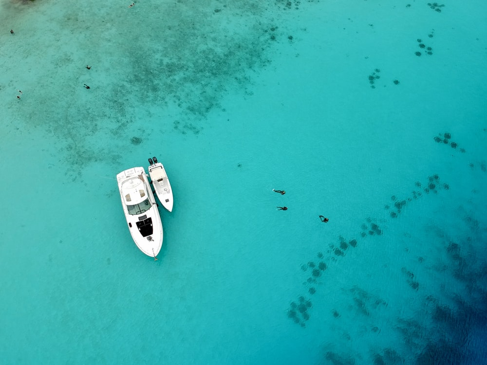 aerial view of white and black boat on sea during daytime