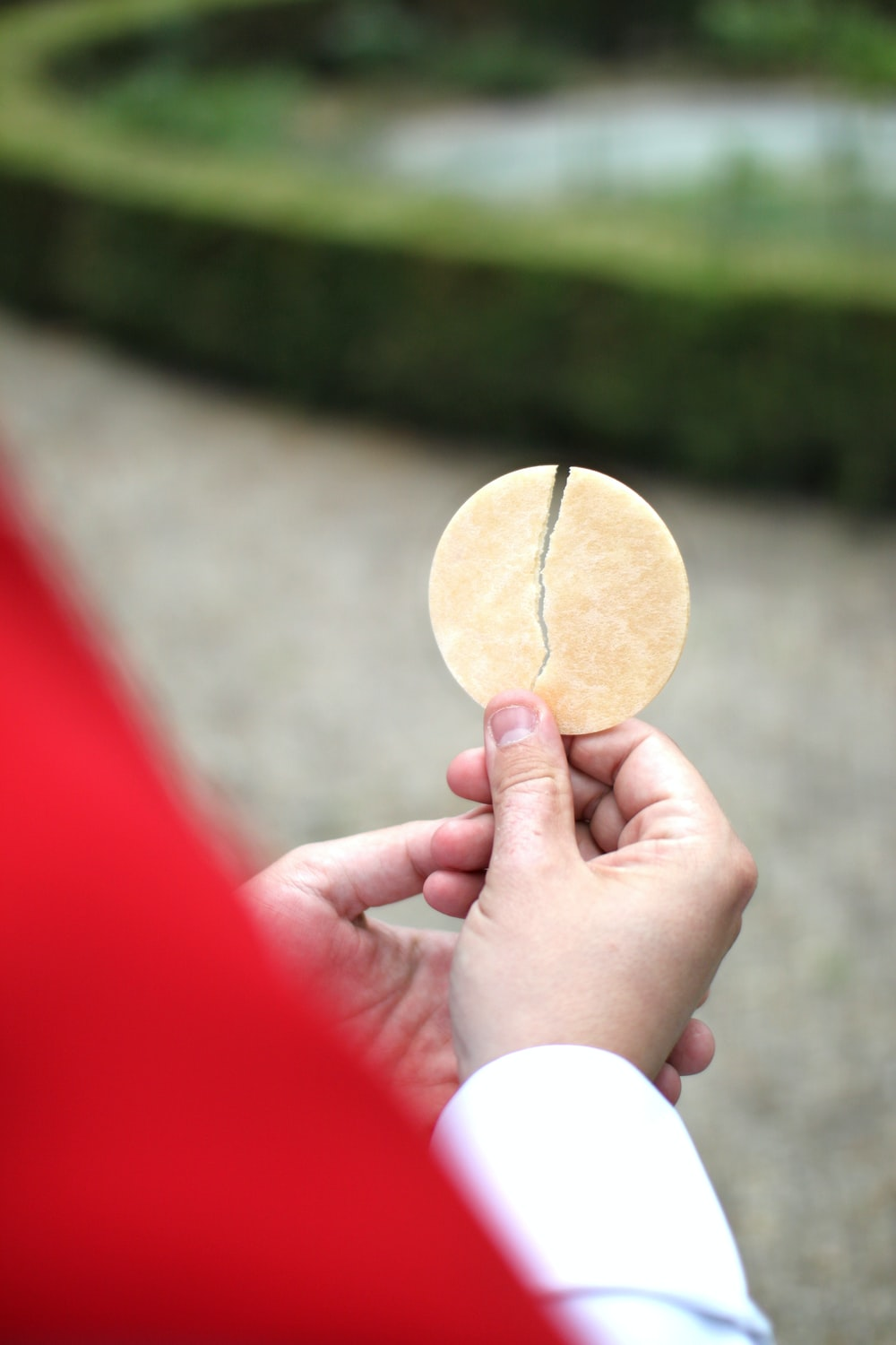 person holding brown round ornament