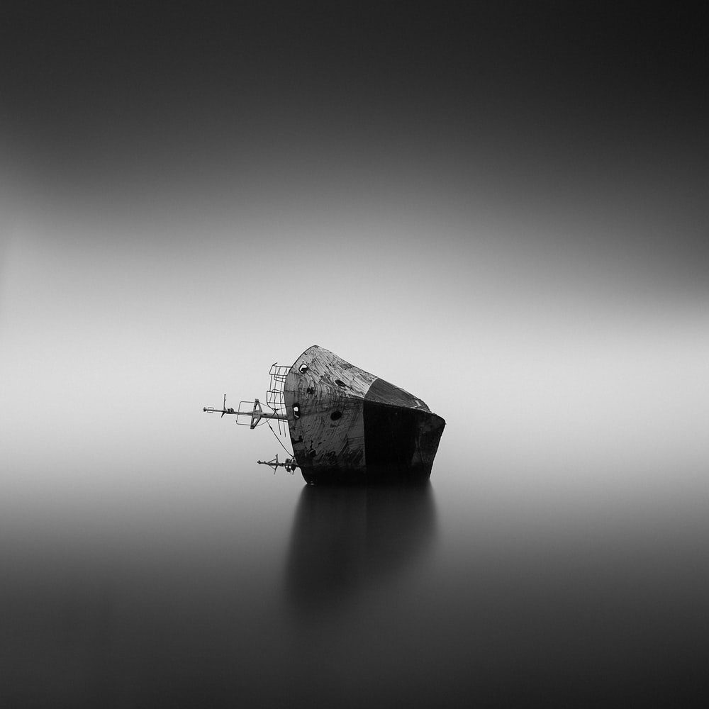 grayscale photo of house on water
