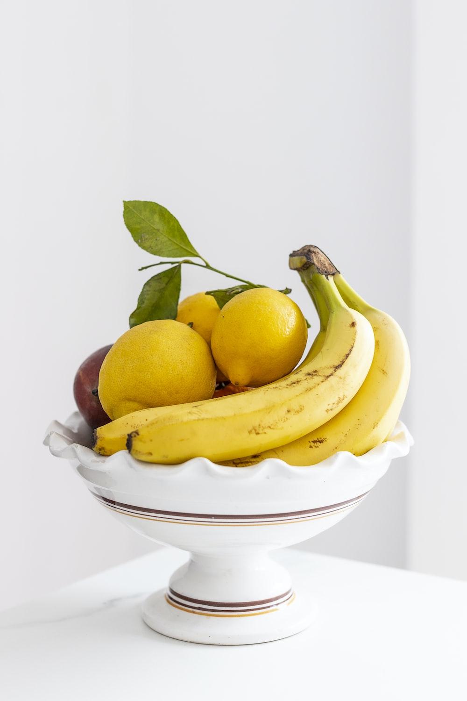yellow banana fruit on white ceramic bowl