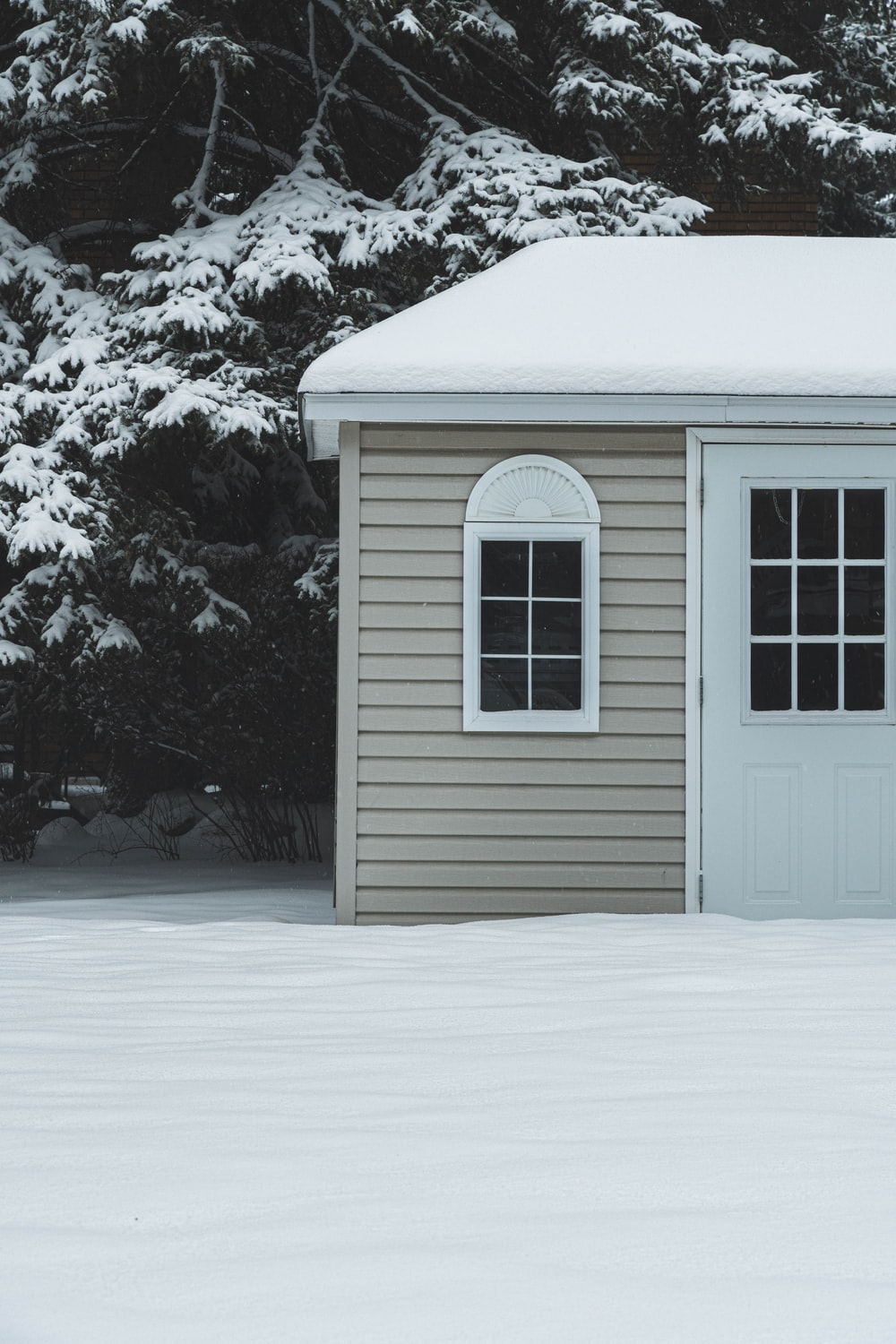 white wooden house covered with snow