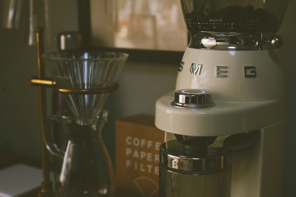 white and black coffee maker