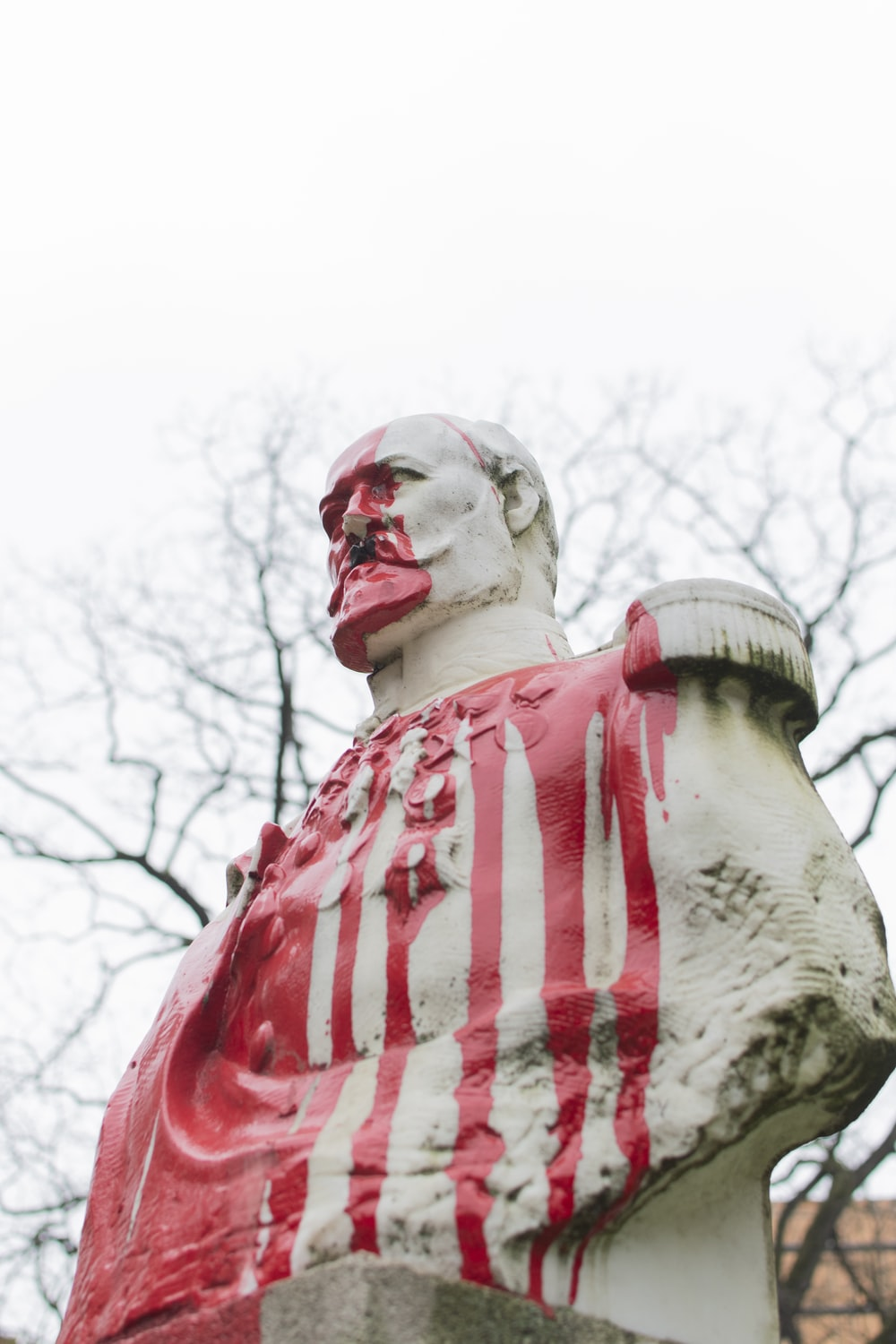 man in red and white stripe shirt statue