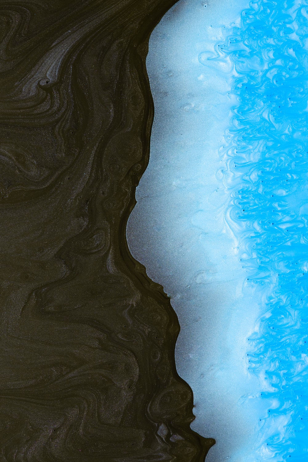 brown sand with blue water