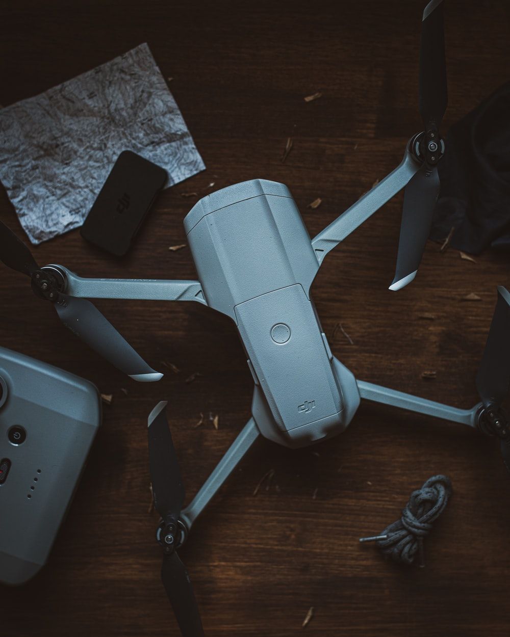 gray and black drone on brown wooden table