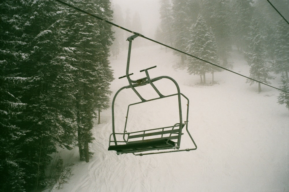 green metal frame on snow covered ground
