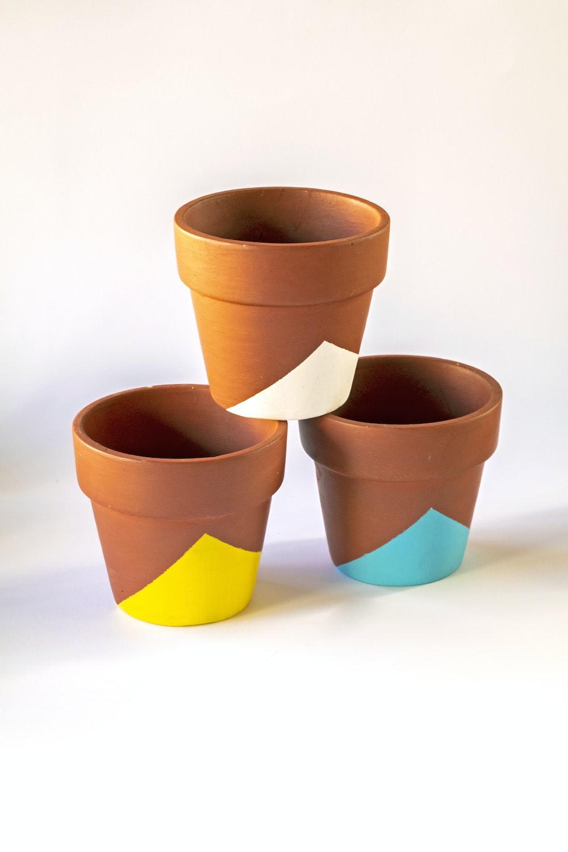 3 orange and blue plastic cups
