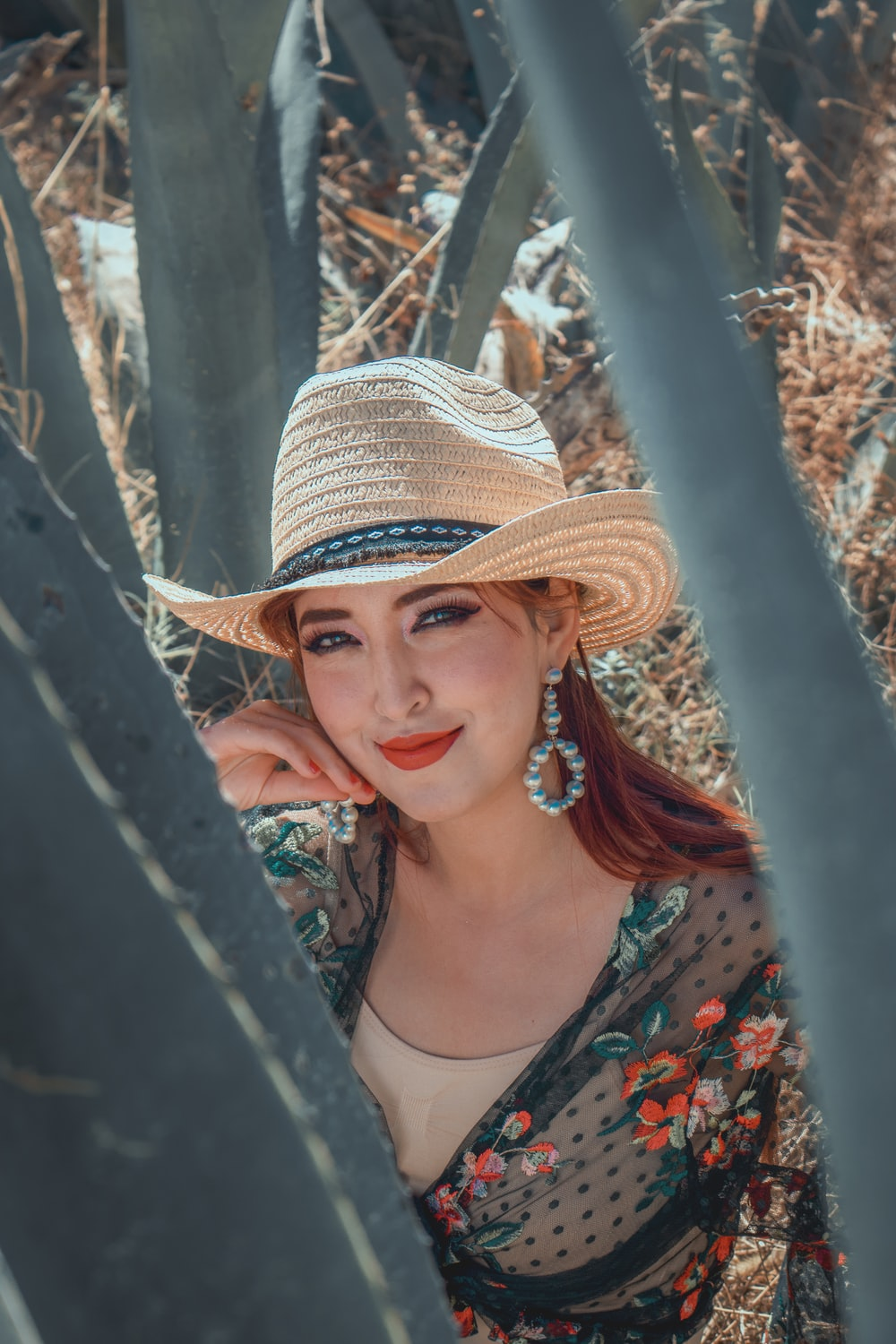 woman in brown and black fedora hat