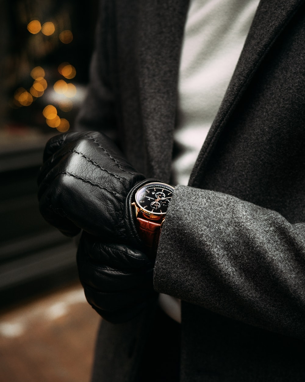 person wearing black leather jacket and silver ring