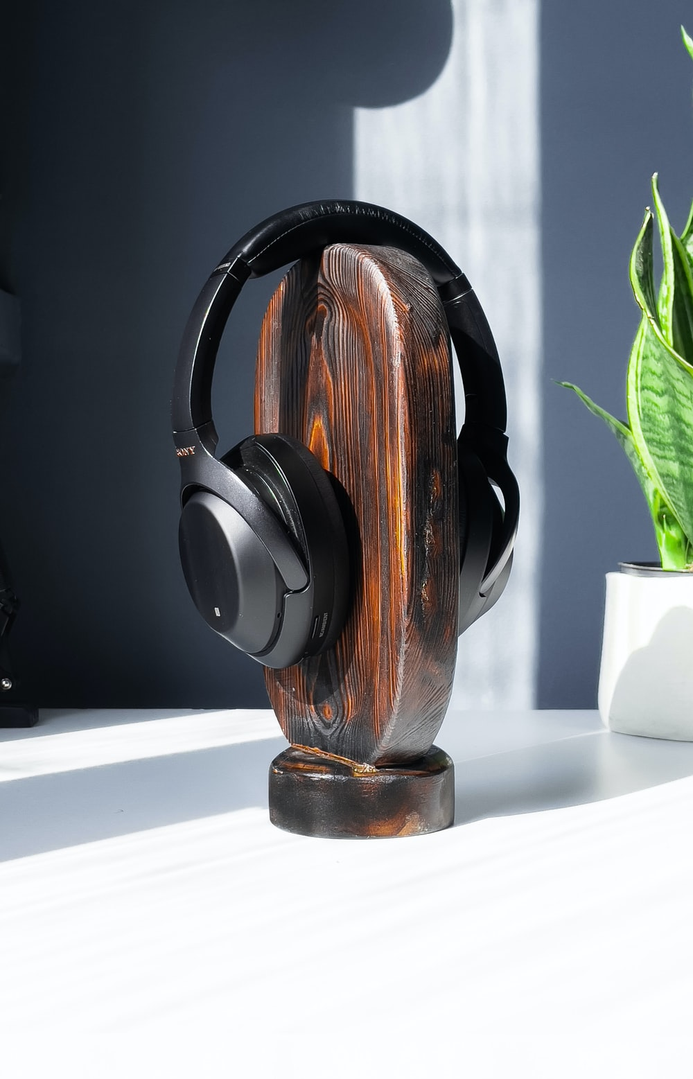 brown and black headphones on white table