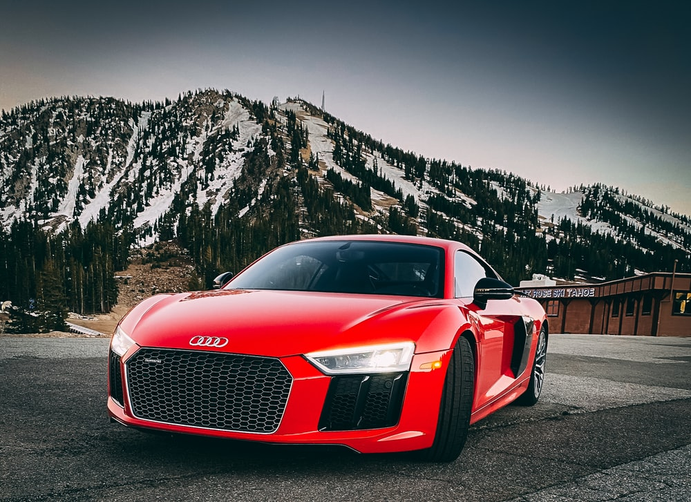 red audi r 8 on road during daytime