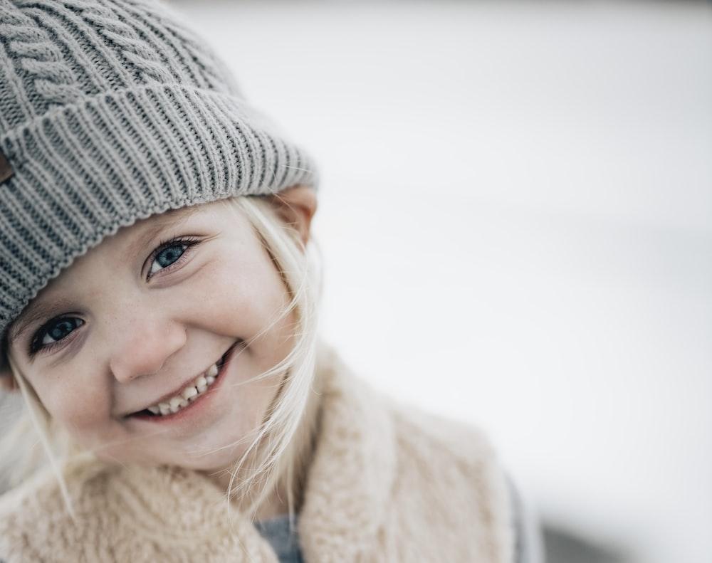 smiling girl in gray knit cap