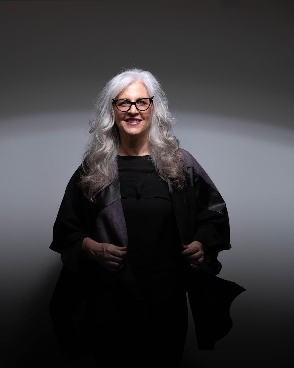woman in black coat wearing eyeglasses