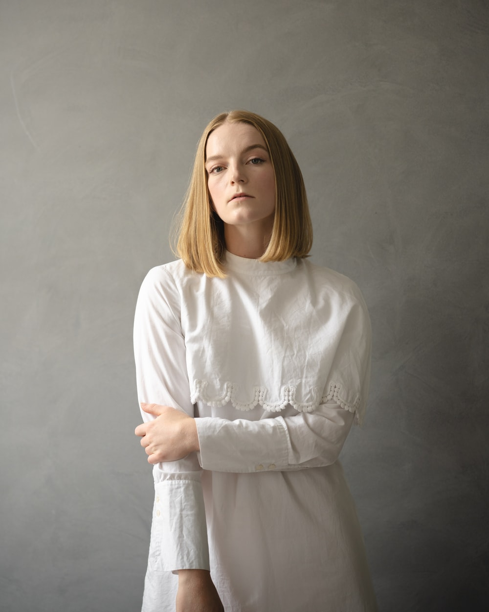 woman in white long sleeve shirt standing
