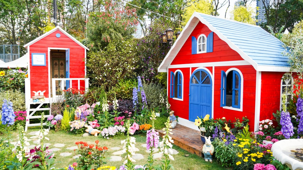 red and blue wooden house near green trees during daytime