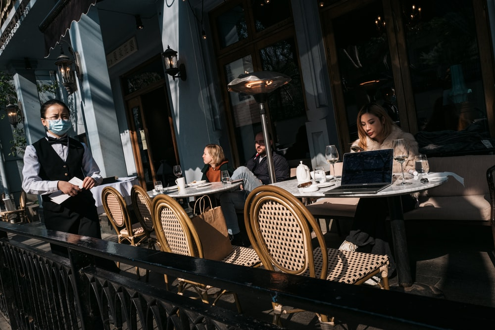 man and woman sitting on chair in restaurant