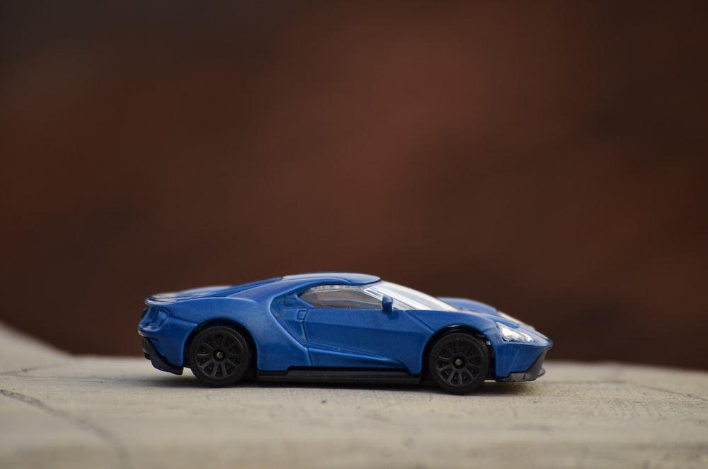 blue ferrari 458 italia on gray pavement
