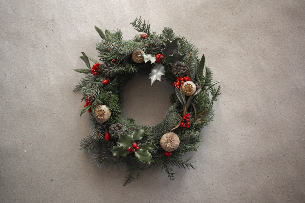 green and brown wreath with baubles