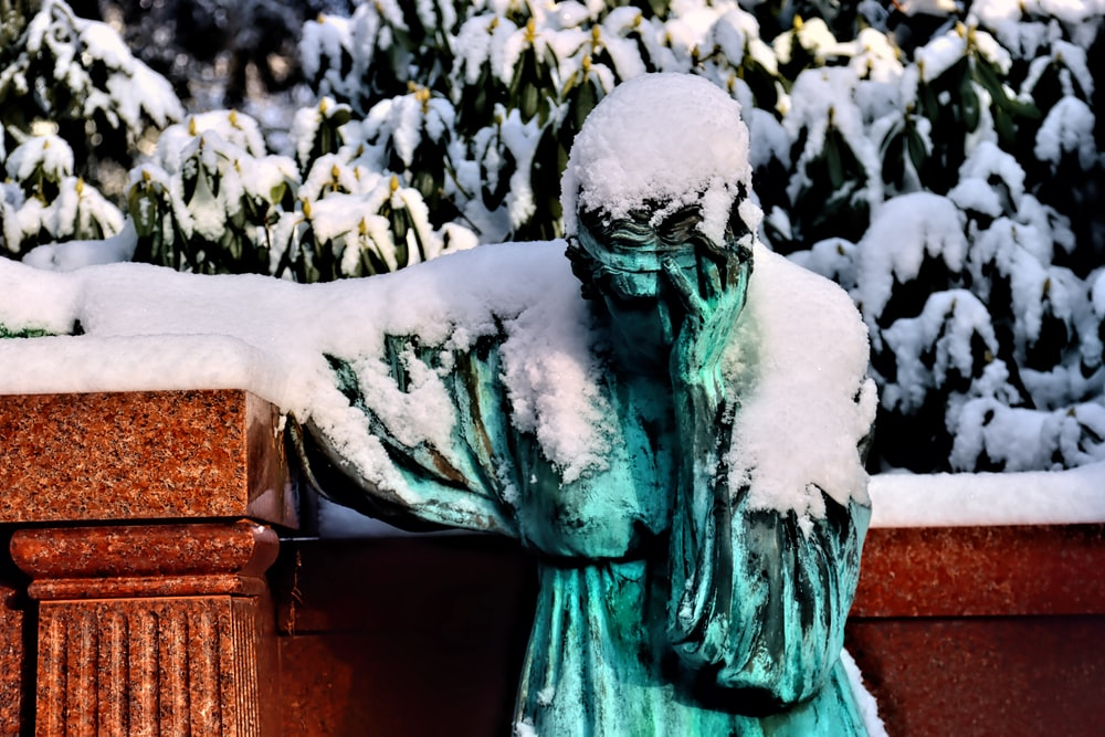 green statue of a man