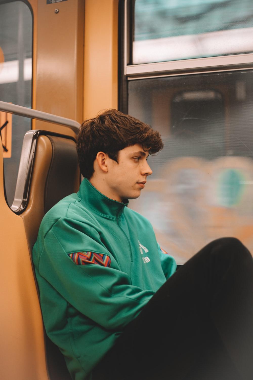 boy in blue hoodie sitting on chair