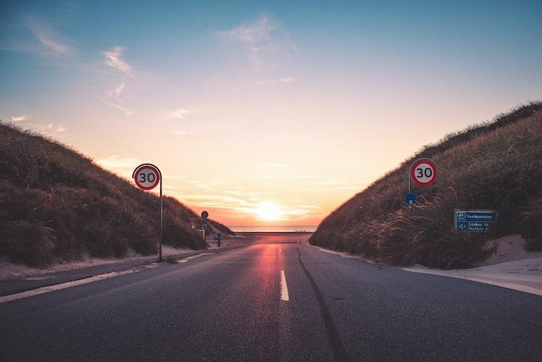 gray asphalt road during sunset