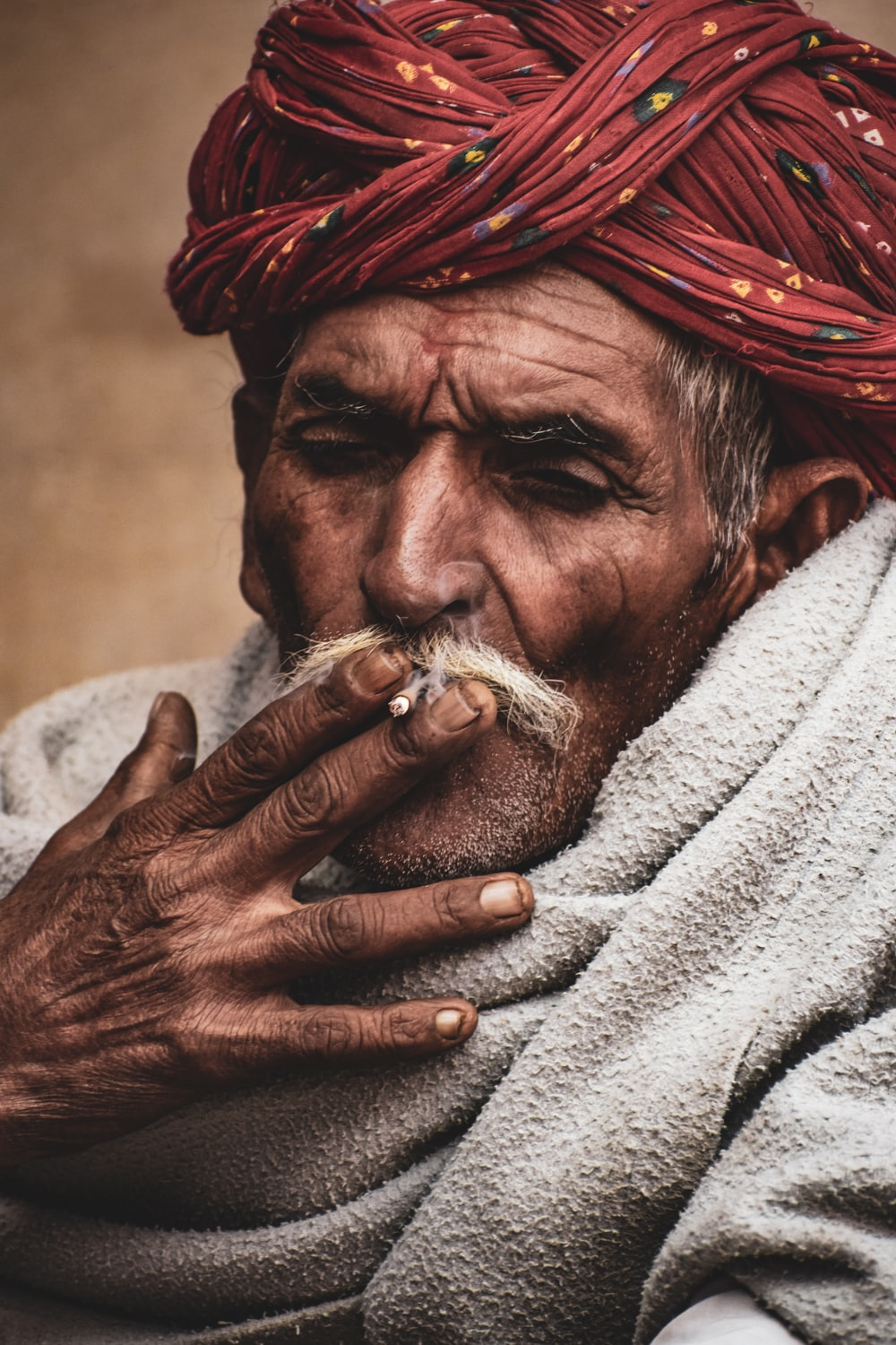 man in red and white turban