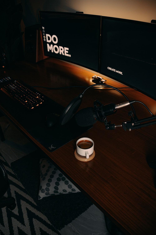 black headphones on black computer table
