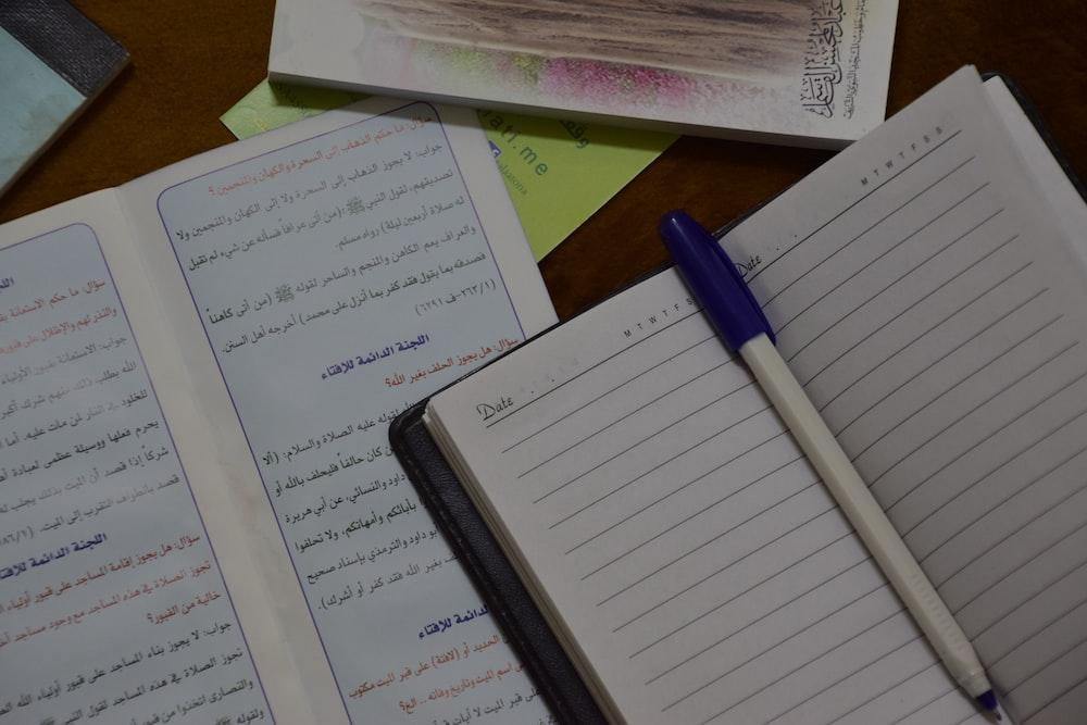 blue pen on white ruled paper