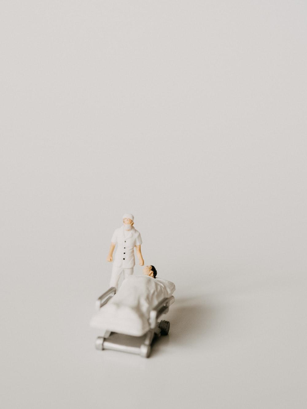 white ceramic figurine on white surface