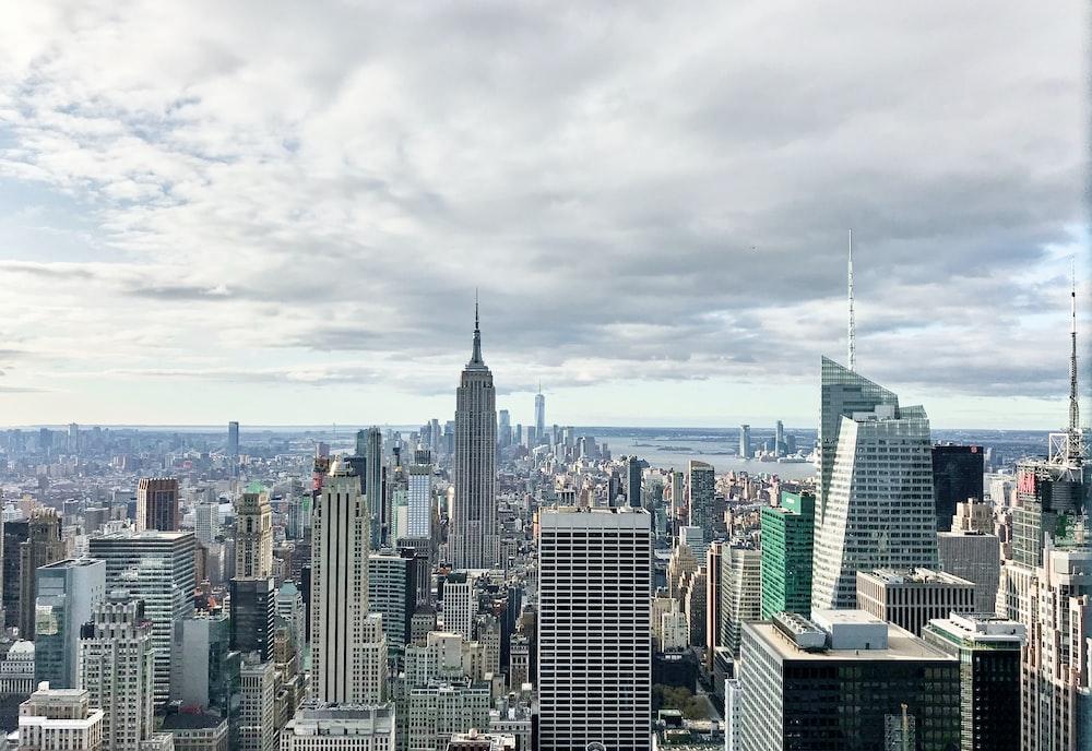 city skyline under white clouds during daytime
