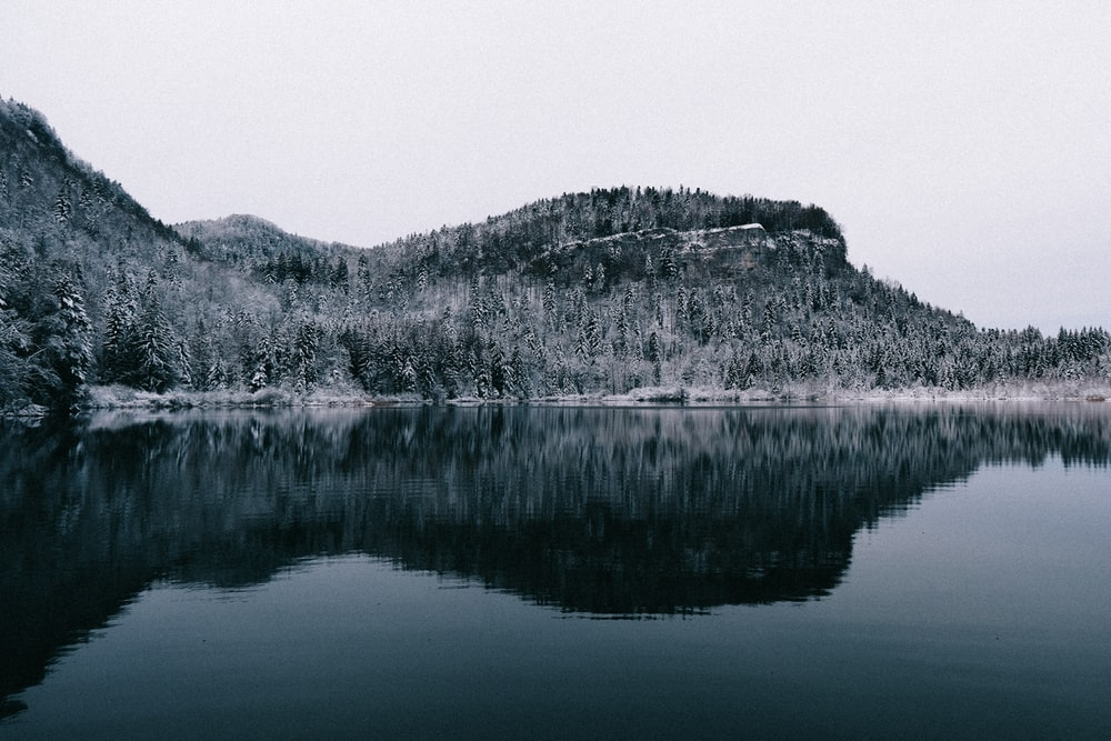grayscale photo of lake and mountain