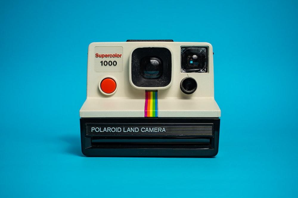 white and black polaroid instant camera