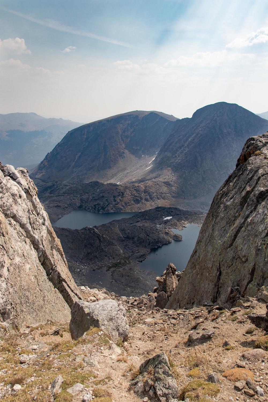 brown rocky mountain near lake during daytime
