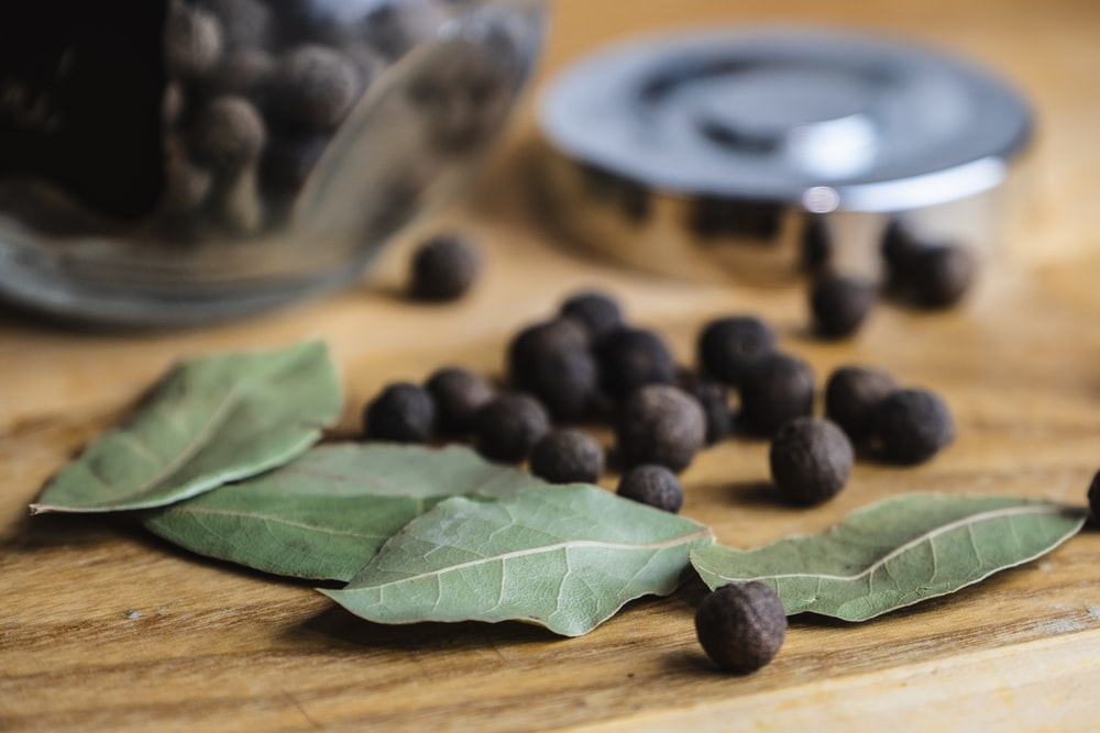 black round fruits on brown wooden table